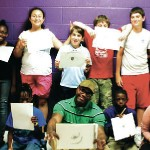 """Muhammad and Walker interact and education students about the dangers that may stem from the """"in crowd."""" From the left to right, back row: KC Sturgis, Carissa Skinner, Sophie Masso, Drew Phelps, Jacob Lee, Connor Reilly, Earon Foley and Kelly Walker. From left to right, front row: Zaye Flemons, Mallory Silver, Tyler Crawley, Shahid Muhammad, Eric Foley and Kellie Mahoney."""