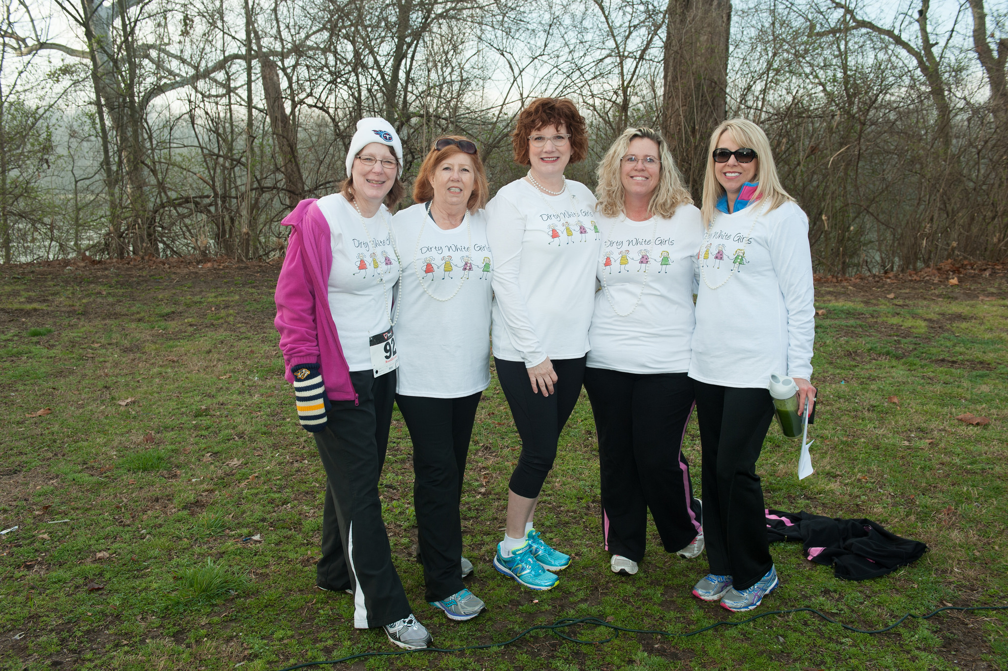 Jenny White (middle) is joined by volunteers at last year's Free to Breathe event.