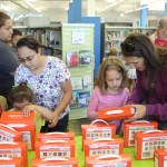 Parents and children at the Southeast Branch check out Launchpads.