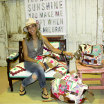 Sheryl Crow sits on an antique settee that was upholstered with one of her antique cutter quilts. On the wall behind her, another of her quilts is displayed behind the words of this familiar song. The third quilt was transformed into a collection of bags in varying sizes. These items were auctioned during last weekend's Pop-up Fair, held at the Factory at Franklin and sponsored by City Farmhouse.