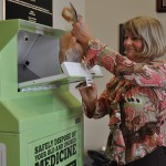 Lori Munkeboe, Director of TDEC's Office of Sustainable Practices, demonstrates how to dispose of medications in a bin in Davidson County.            - photo courtesy of TDEC