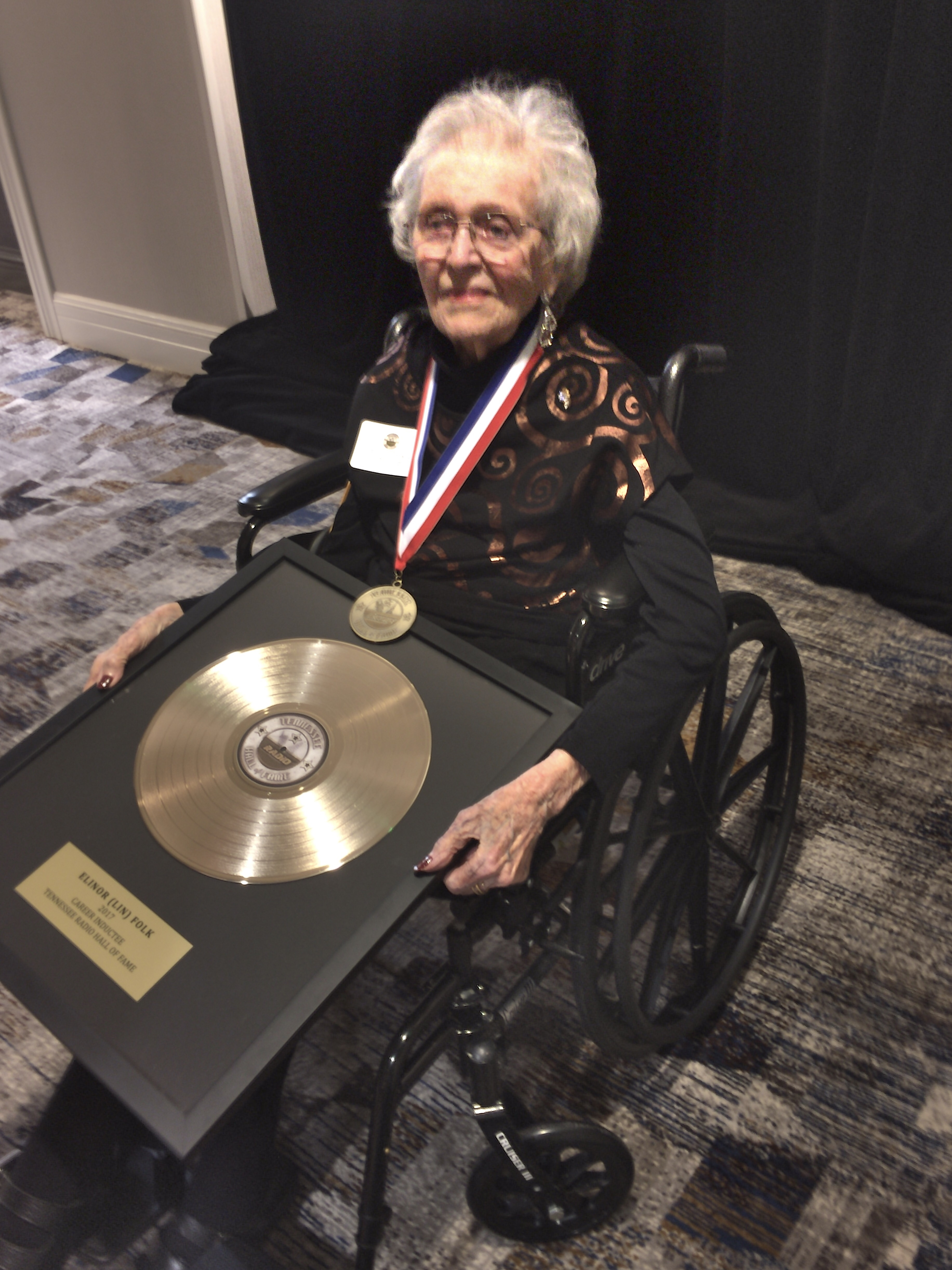Pioneer broadcaster Lin Folk displayed her TN Radio Hall of Fame gold record and plaque after her induction.