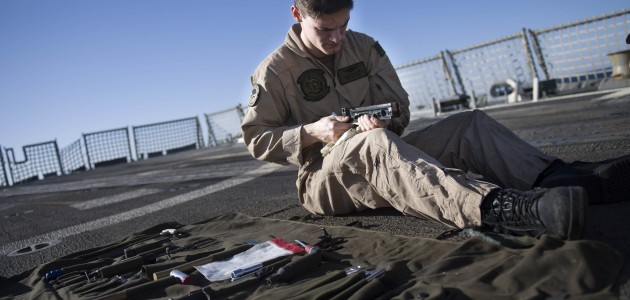 171205-N-IA905-1053 ARABIAN GULF (Dec. 5, 2017) Naval Air Crewman (Helicopter) 2nd Class Brandon T. Railey cleans part of a .50-caliber machine gun aboard the Arleigh Burke-class guided-missile destroyer USS Preble (DDG 88). Preble is deployed with the Theodore Roosevelt Carrier Strike Group to the U.S. 5th Fleet area of operations in support of maritime security operations to reassure allies and partners and preserve the freedom of navigation and the free flow of commerce in the region. (U.S. Navy photo by Mass Communication Specialist 3rd Class Morgan K. Nall/Released)