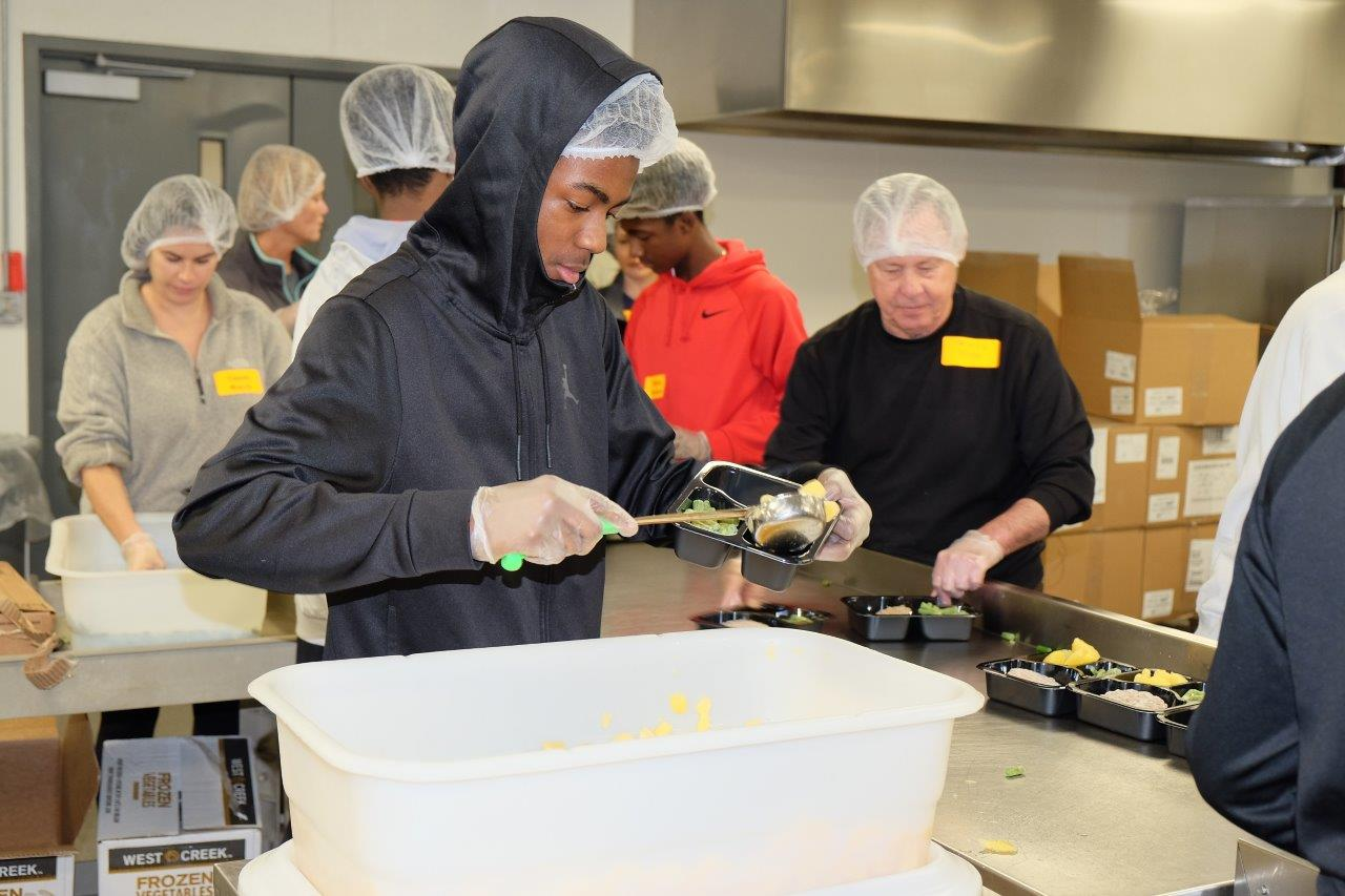 Volunteers providing basic food service at Second Harvest Food Bank.                - photo courtesy Rotary Club of Nashvill