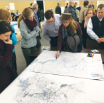 At the open house hosted by the Metropolitan Transit Authority (MTA) on November 30 residents in Bellevue discussed the ways light rail would impact the area. - photo by David Smith